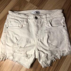 Guess white jean shorts.